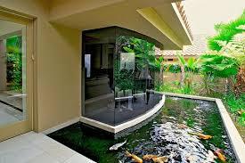 kolam ikan koi depan rumah